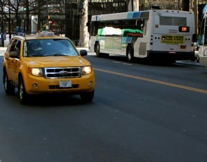 Yellow Cab and city bus